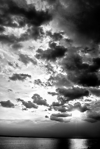 black and white picture of a sunset and cloudscapes - Photography by Neha Gupta