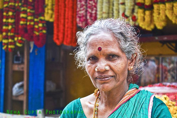 Tamilian female portrait, flower seller in a market