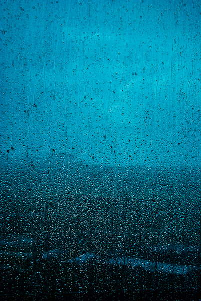 Monsoon rain on a glass window